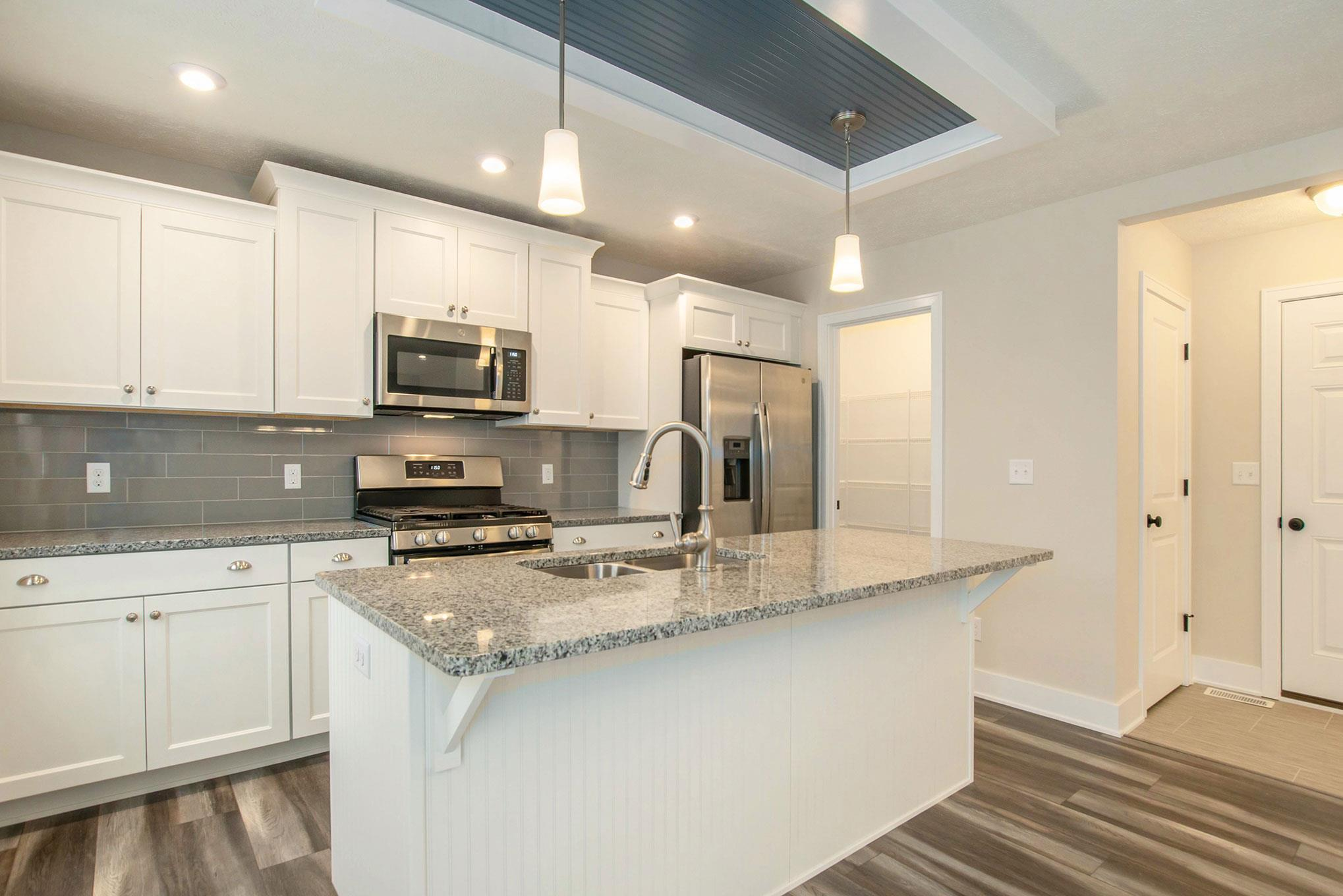 Kitchen featured in The Rowen By Eastbrook Homes Inc. in Lansing, MI