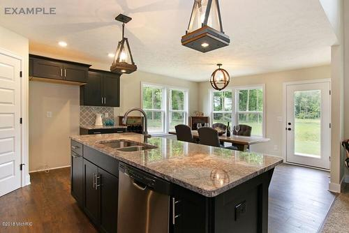 Kitchen-in-The Hadley-at-Lowing Woods-in-Jenison