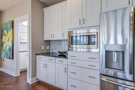 Kitchen-in-The Newport-at-Preservation Lakes-in-Byron Center