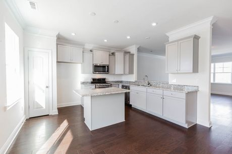 Kitchen-in-Kensington-at-Wynwood at FoxCreek Townhomes-in-Moseley