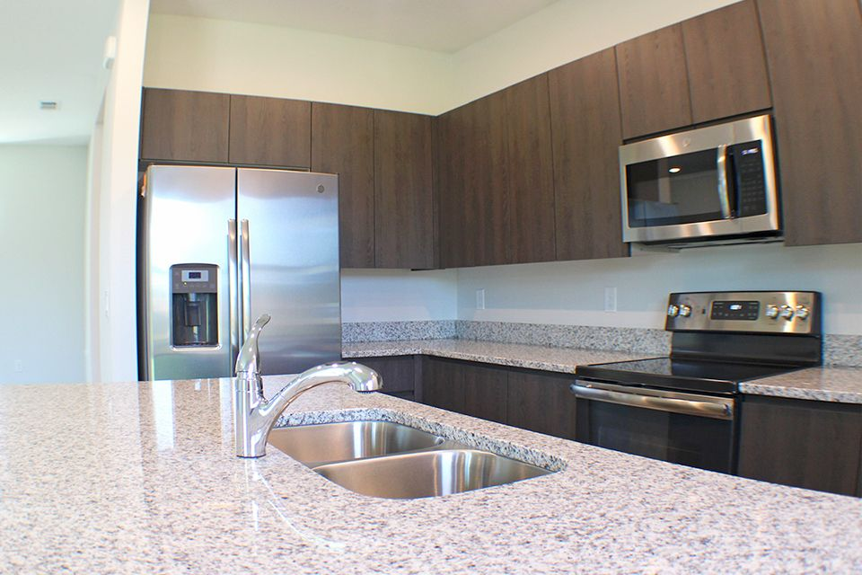 Kitchen featured in the Veneto By EcoSun Homes in Melbourne, FL