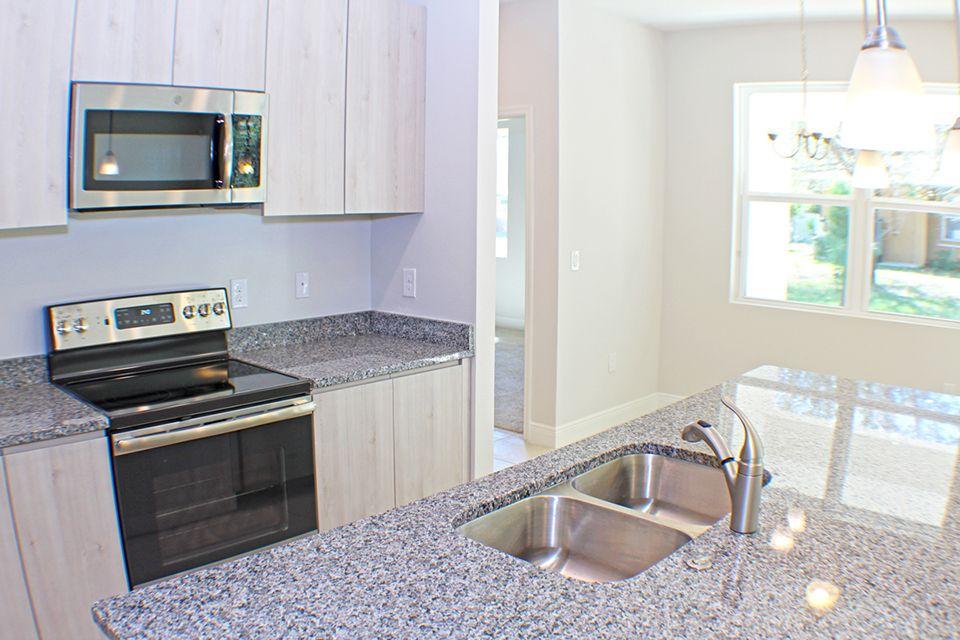 Kitchen featured in the Lazio By EcoSun Homes in Melbourne, FL