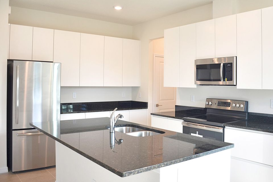 Kitchen featured in the Calabria By EcoSun Homes in Melbourne, FL