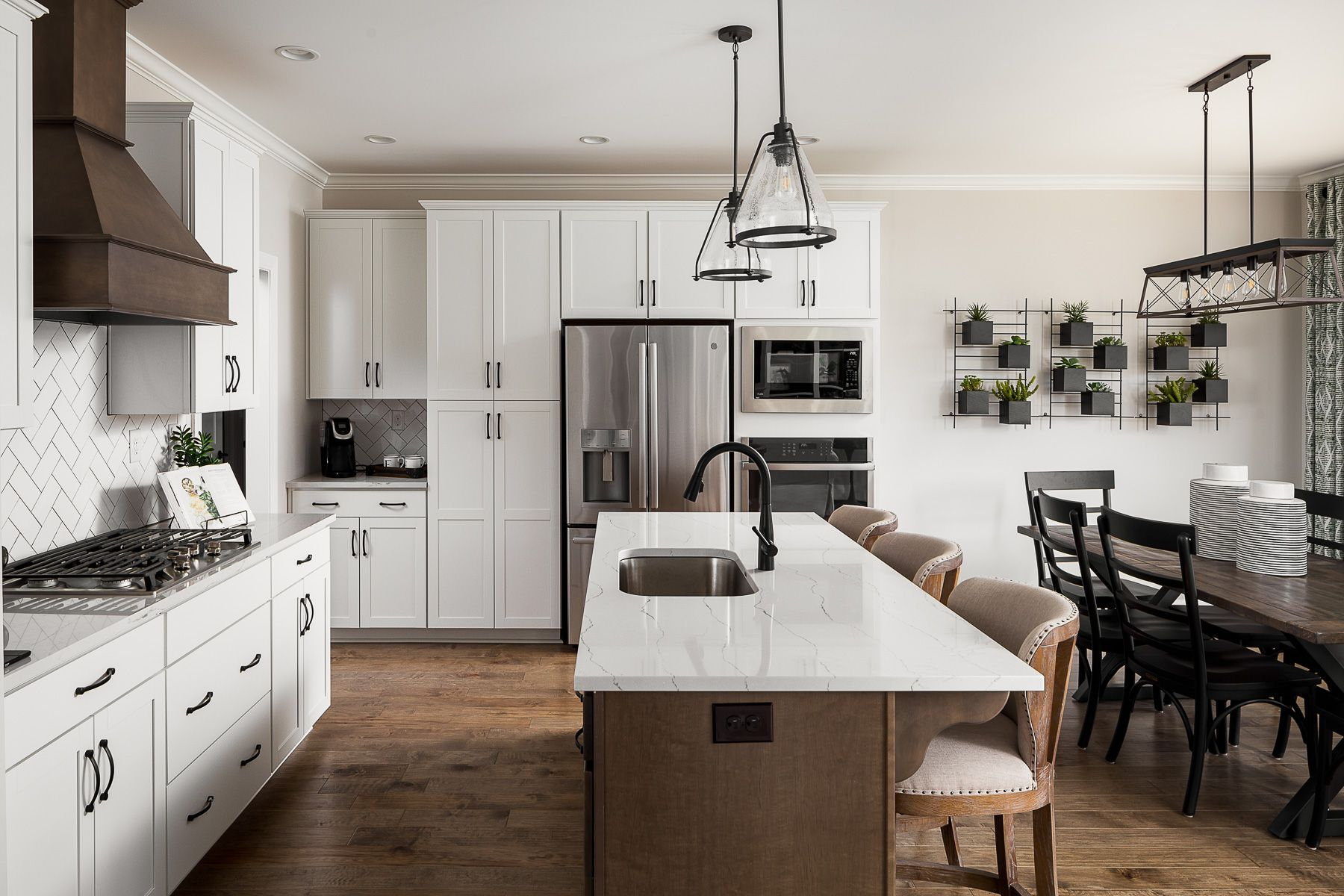 Kitchen featured in The Jamestown with Front Entry Garage By Elite Built Homes LLC