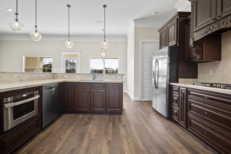 Kitchen featured in The Audrey By Elliott Homes in Biloxi, MS