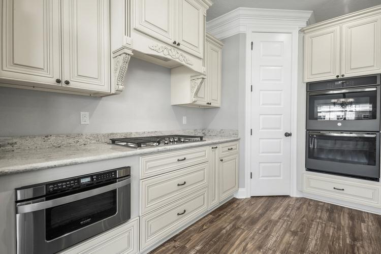 Kitchen featured in The Charles By Elliott Homes in Biloxi, MS