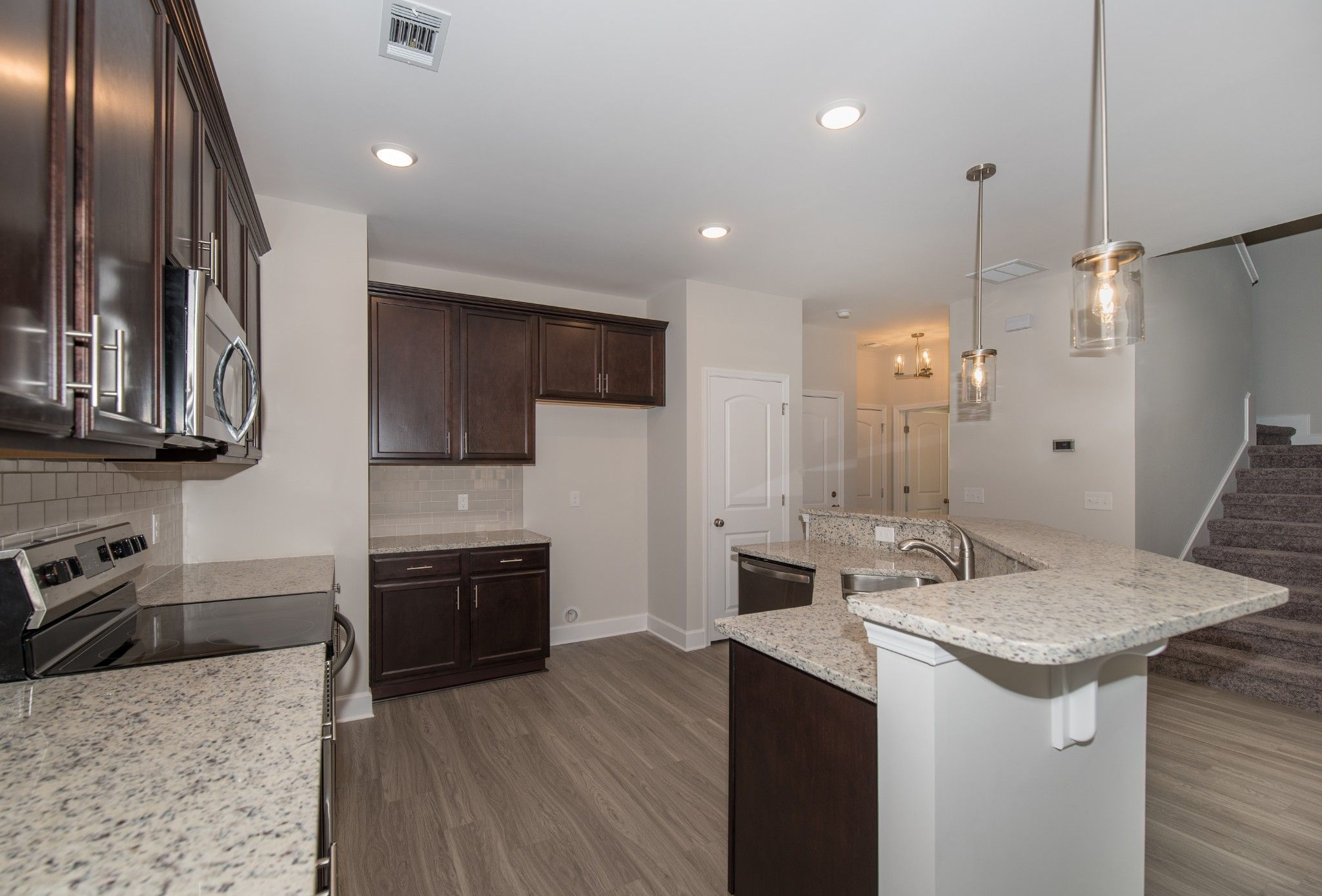Kitchen featured in the Madison By Ernest Homes in Savannah, GA
