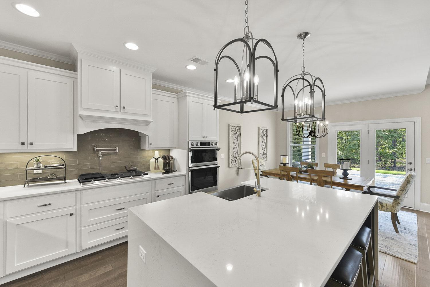 Kitchen featured in the Northwood Villas-Sawgrass III By Executive Construction Homes