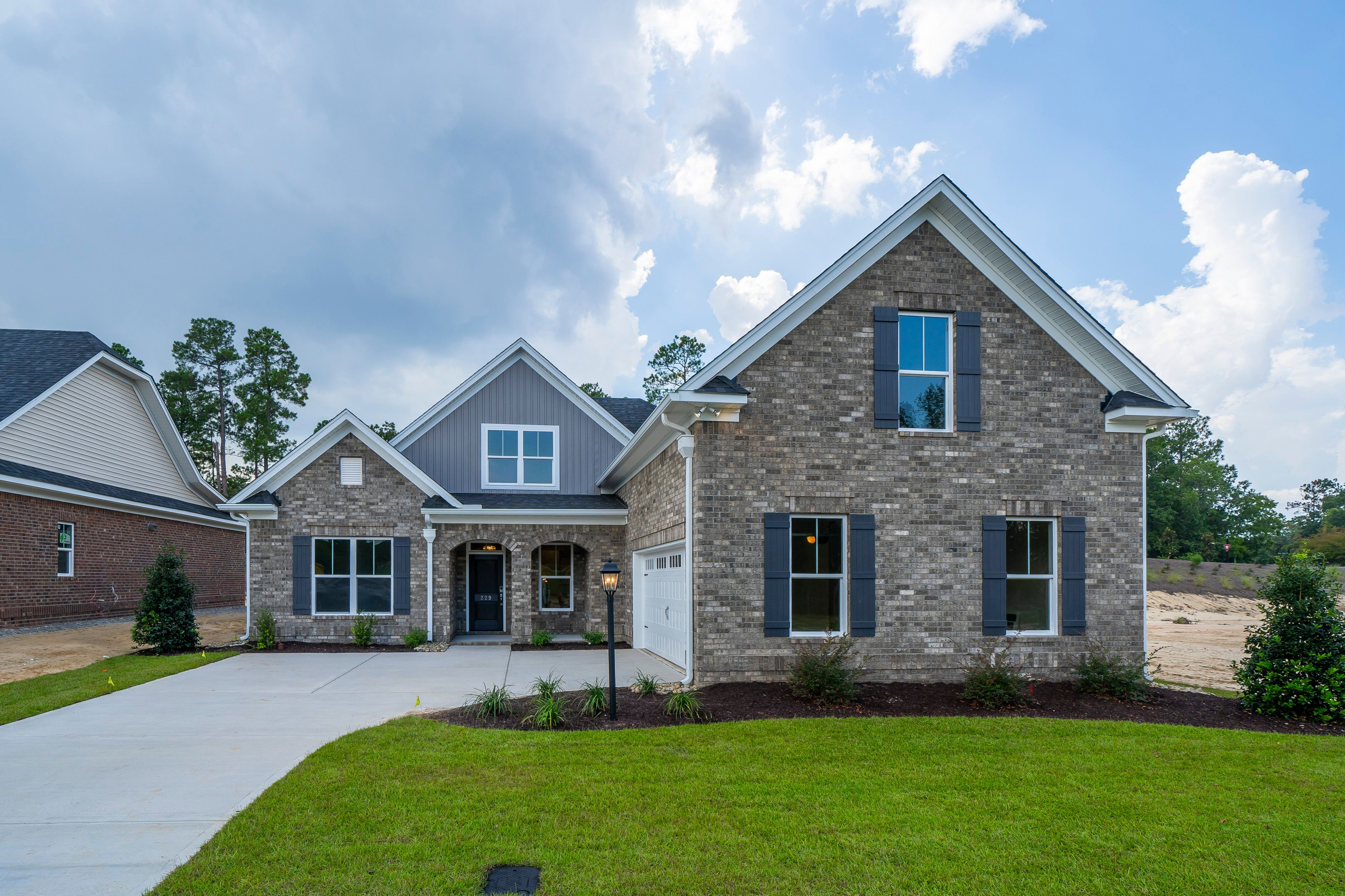 Exterior featured in the Northwood Villas-Augusta III By Executive Construction Homes