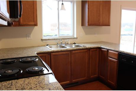 Kitchen-in-Rose Hollow-at-Queens Park-in-West Henrietta