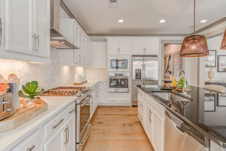 Kitchen-in-Aura-at-Trinity Creek-in-Holly Springs
