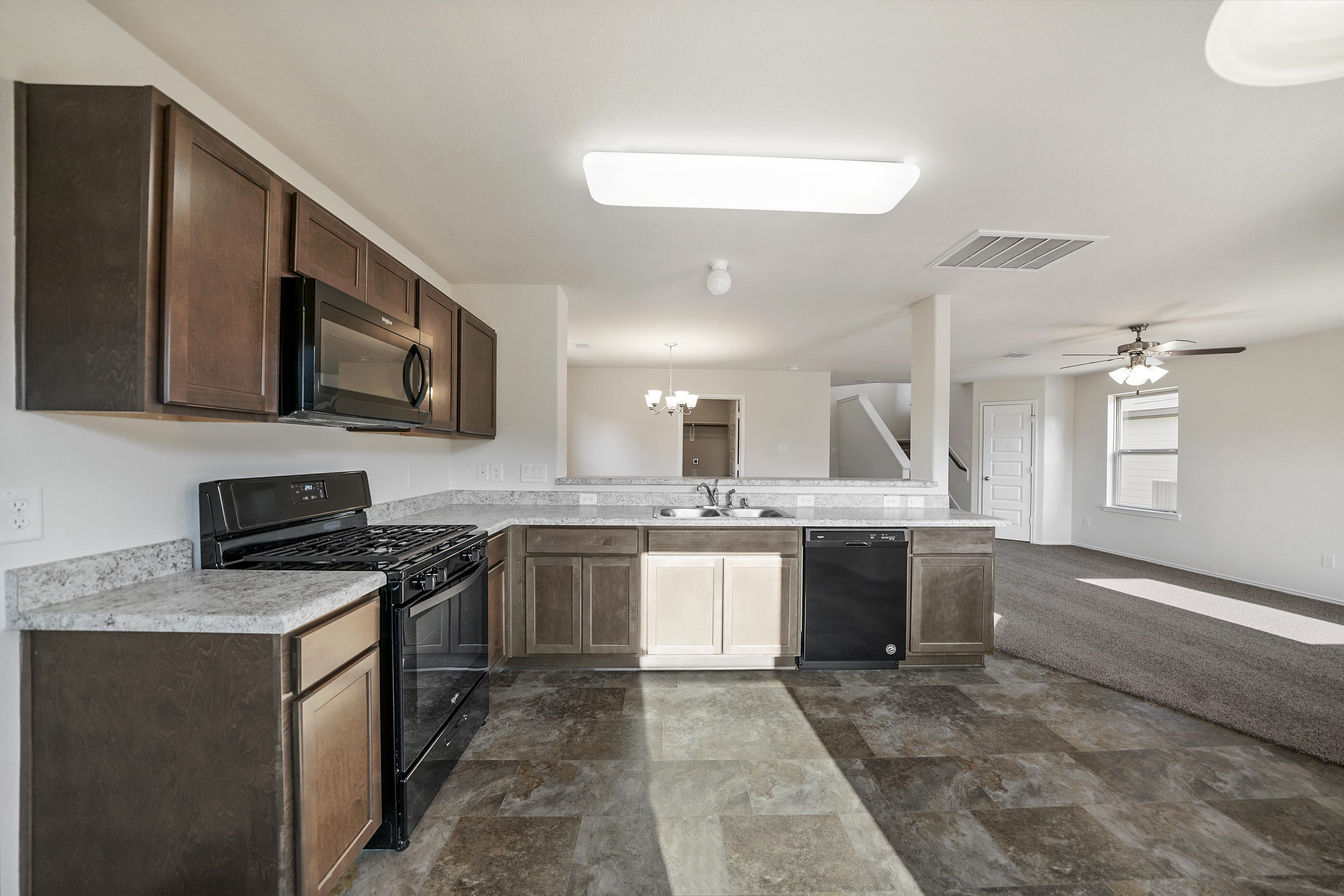 Kitchen featured in the Pecos By First America Homes in Houston, TX