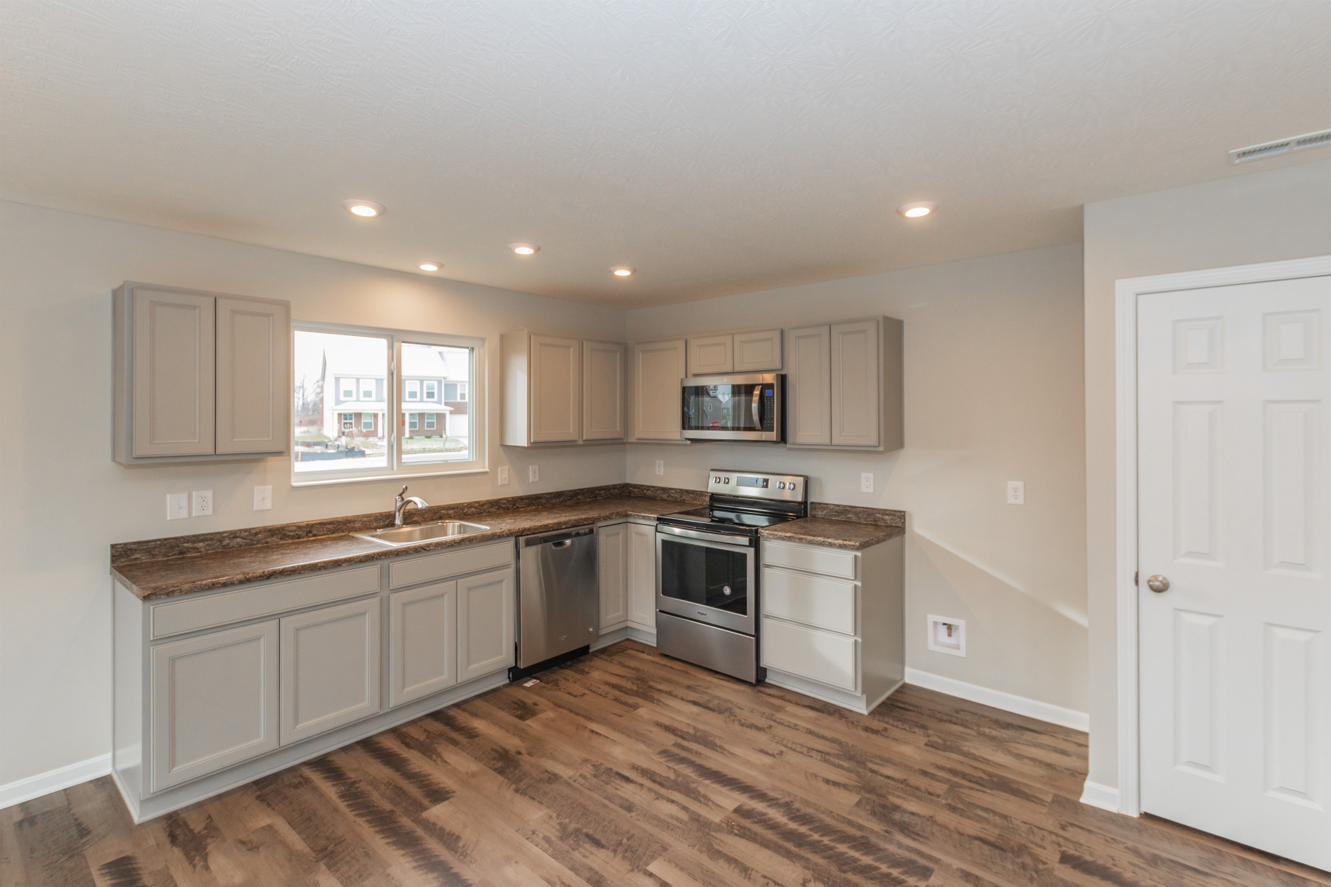 Kitchen featured in the Beacon By Fischer Homes  in Dayton-Springfield, OH