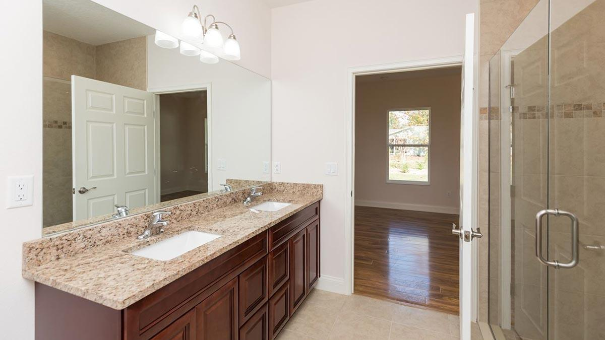 Bathroom featured in the Daniella II. Aging in Place Home By Florida Green Construction