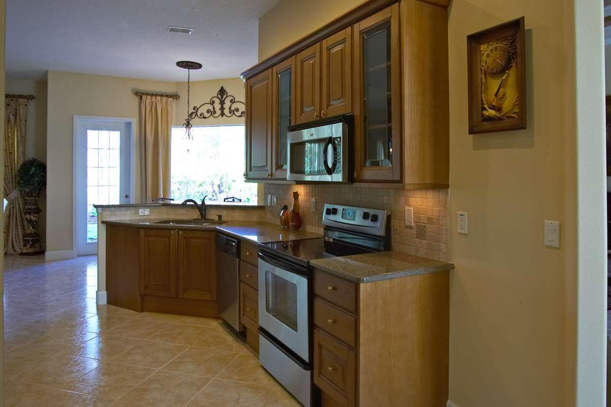 Kitchen featured in the BIRCHWOOD 2 story. Certified Green Home By Florida Green Construction