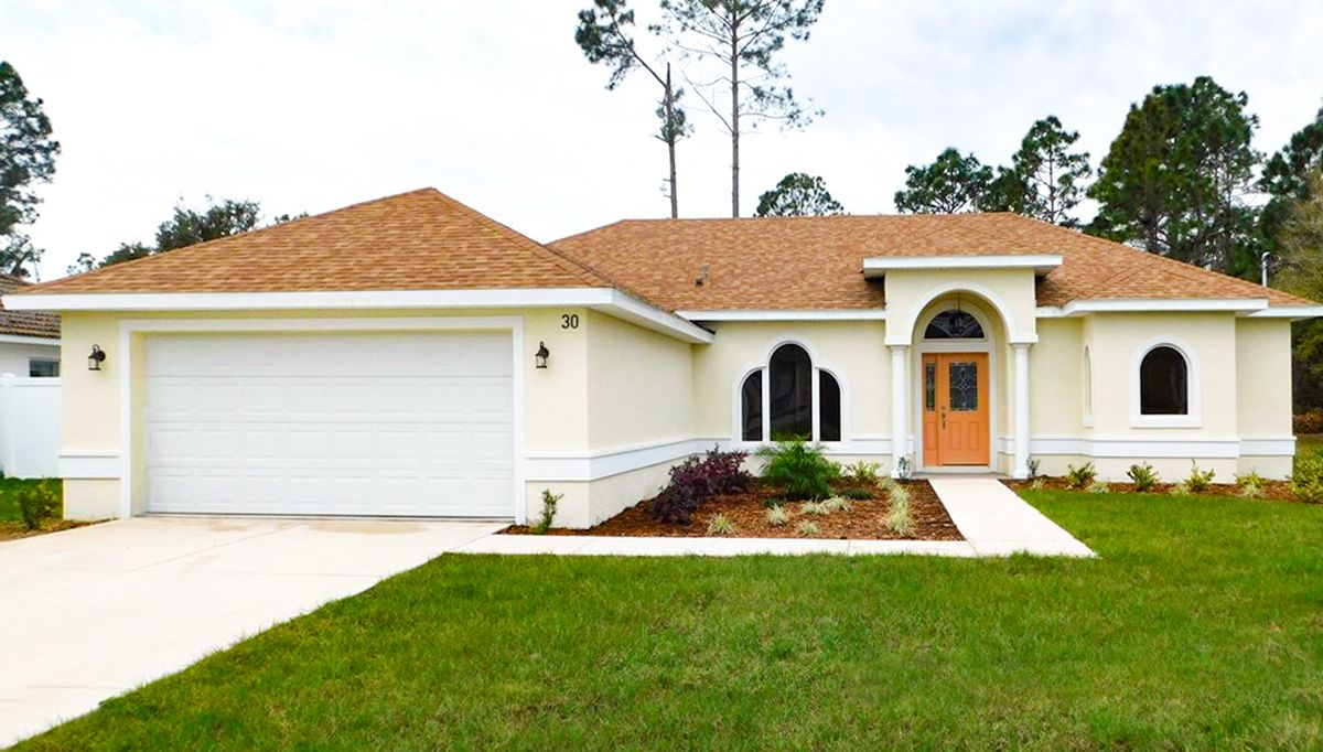 Exterior featured in the PALM II. Aging in place Certified Green Home By Florida Green Construction