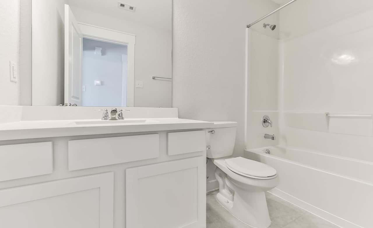 Bathroom featured in the Landmark Series - Kimbell By Gray Point Homes in Houston, TX