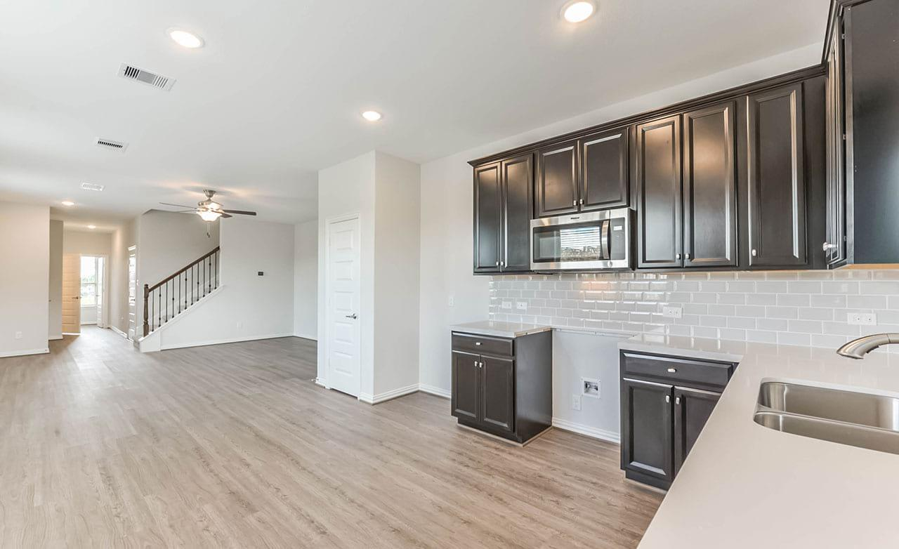 Kitchen featured in the Townhome Series - Yosemite F By Gehan Homes in Houston, TX
