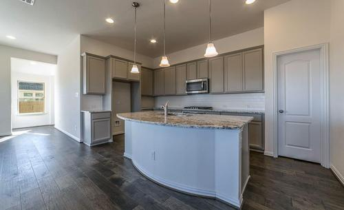 Kitchen-in-Mahogany-at-The Park at Blackhawk - Premier-in-Pflugerville
