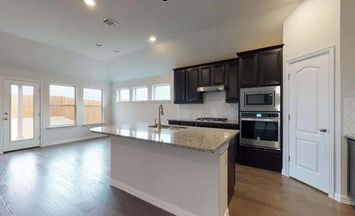 Kitchen-in-Palm-at-Fairways of Champions Circle-in-Fort Worth