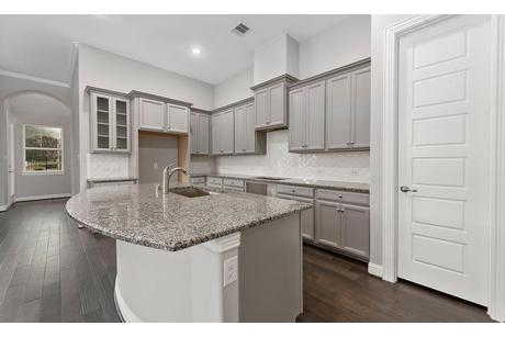 Kitchen-in-Mahogany-at-The Woodlands Hills-in-Conroe