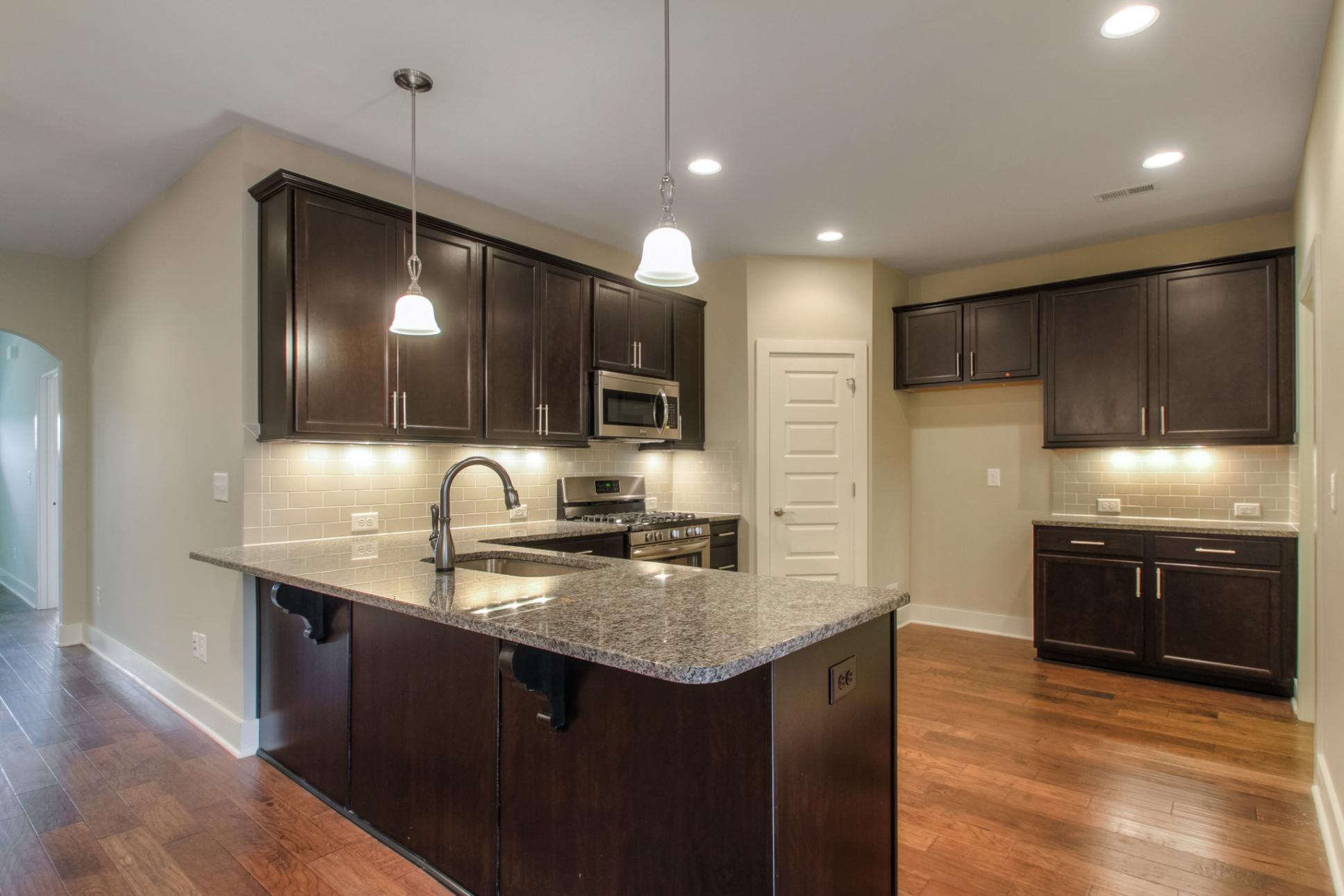 Kitchen featured in The Waverleigh Courtyard Cottage By Goodall Homes in Knoxville, TN