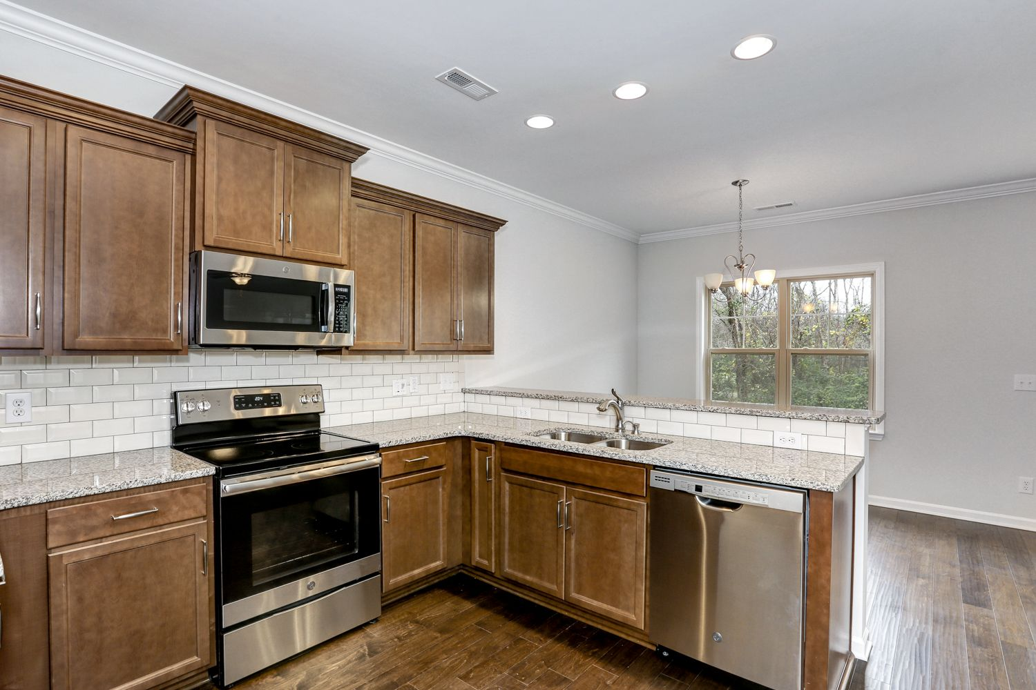 Kitchen featured in The Richardson By Goodall Homes in Huntsville, AL