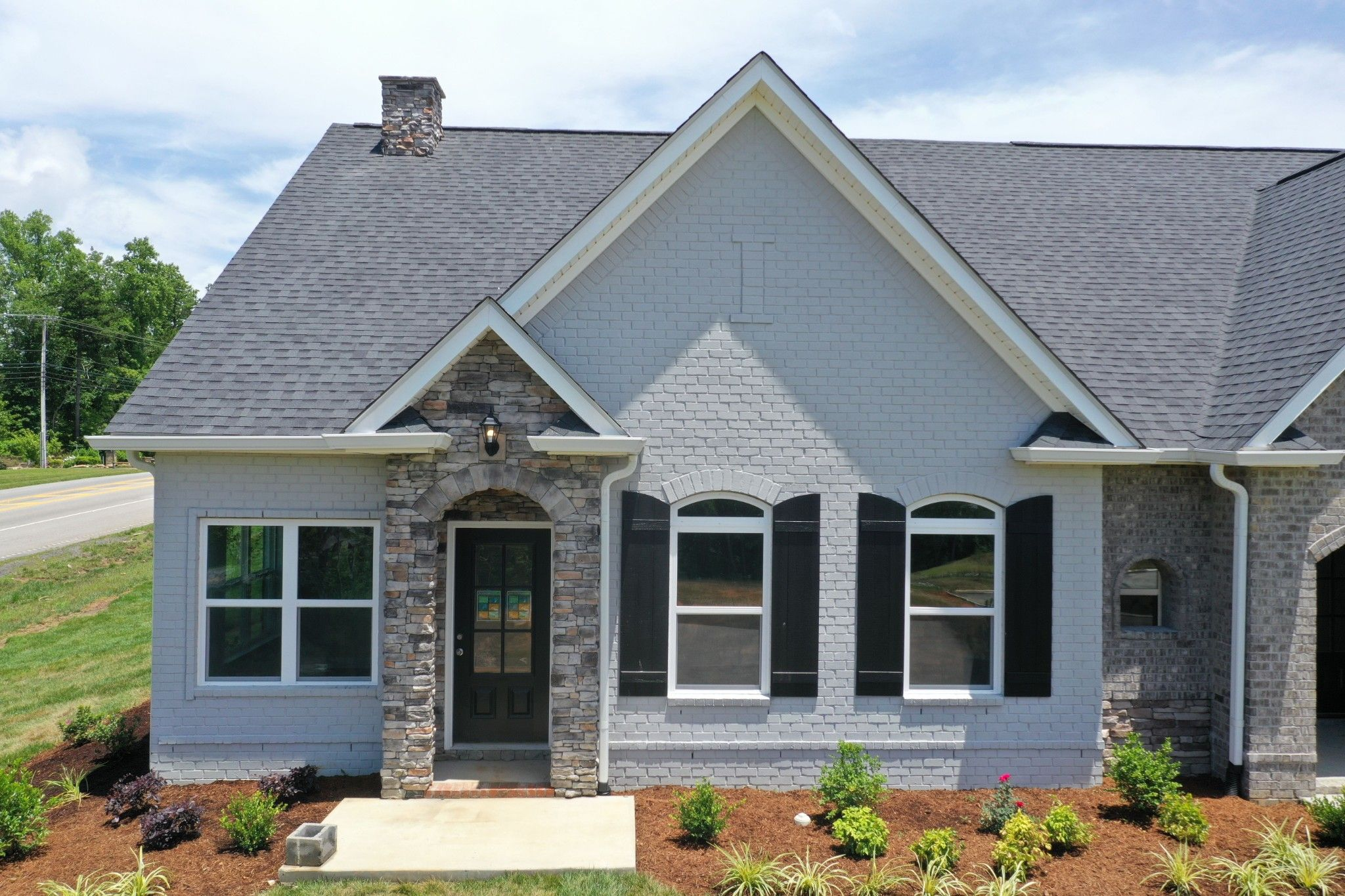 Exterior featured in The Raleigh Courtyard Cottage By Goodall Homes in Chattanooga, GA