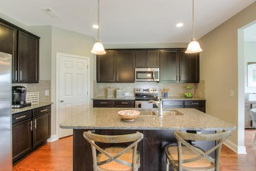 Kitchen-in-The Woodmont-at-Summerlin-in-White House