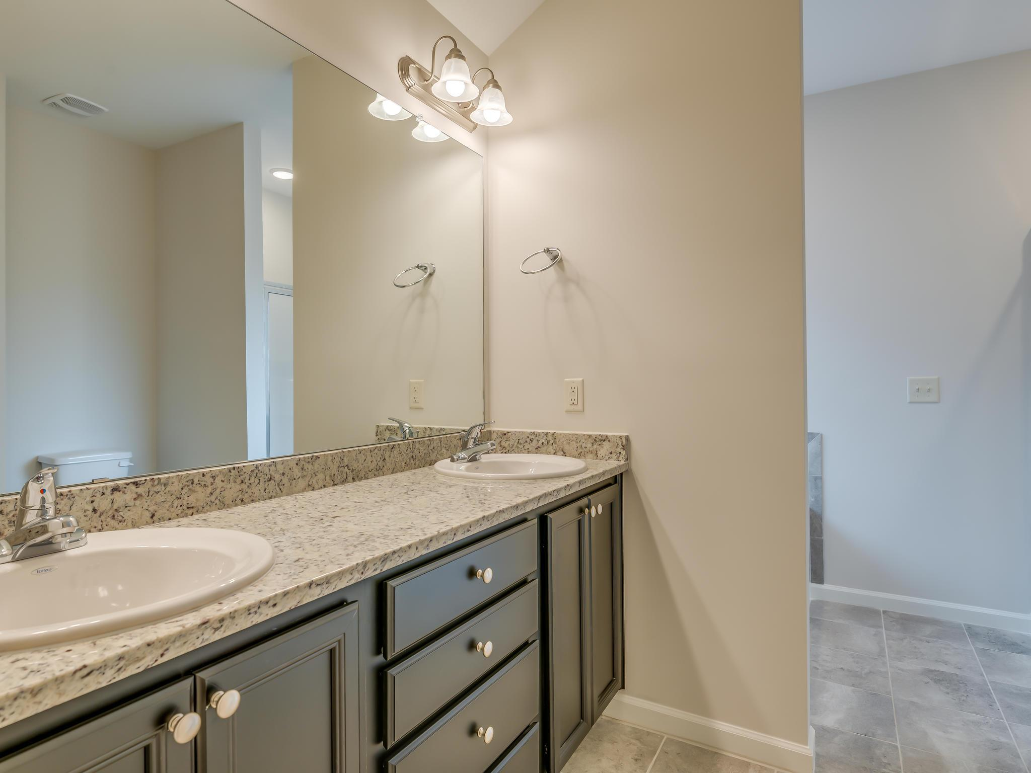 Bathroom featured in the Palmetto By Goodwyn Building in Montgomery, AL