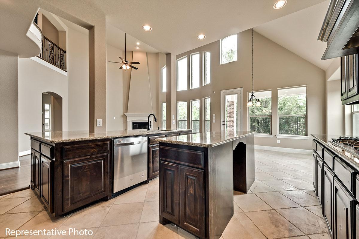Kitchen featured in the Provence II By Grand Homes in Dallas, TX