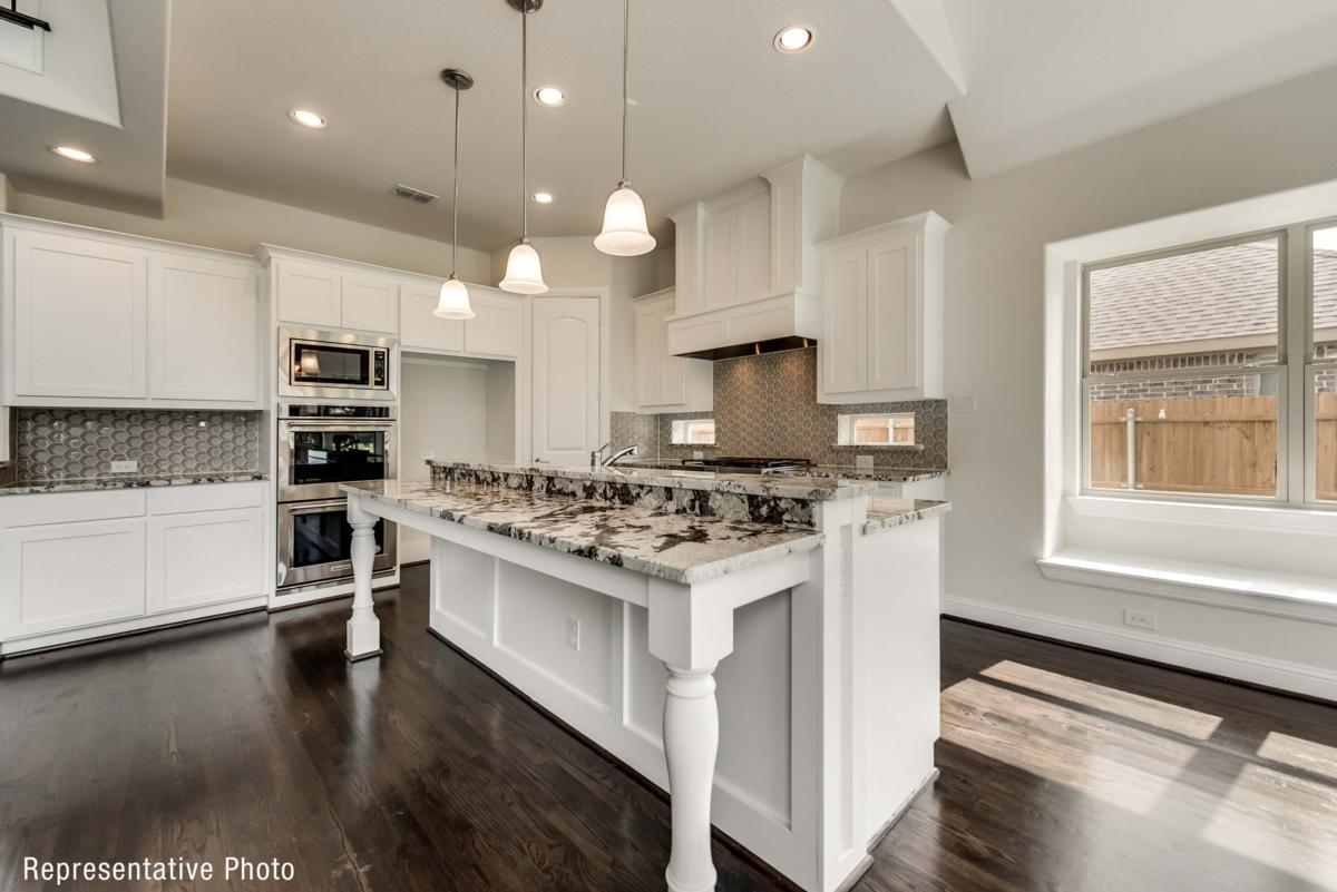 Kitchen featured in the Provence II By Grand Homes in Fort Worth, TX