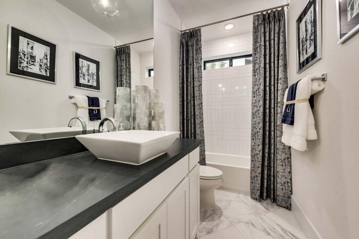Bathroom featured in the Grand Whitehall - 3rd Car Garage By Grand Homes in Fort Worth, TX