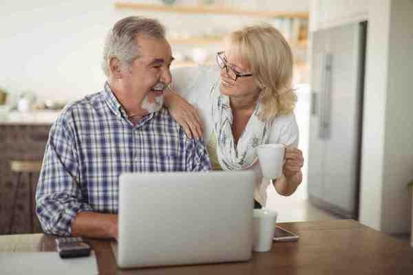 happy-retired-couple-laptop.jpg