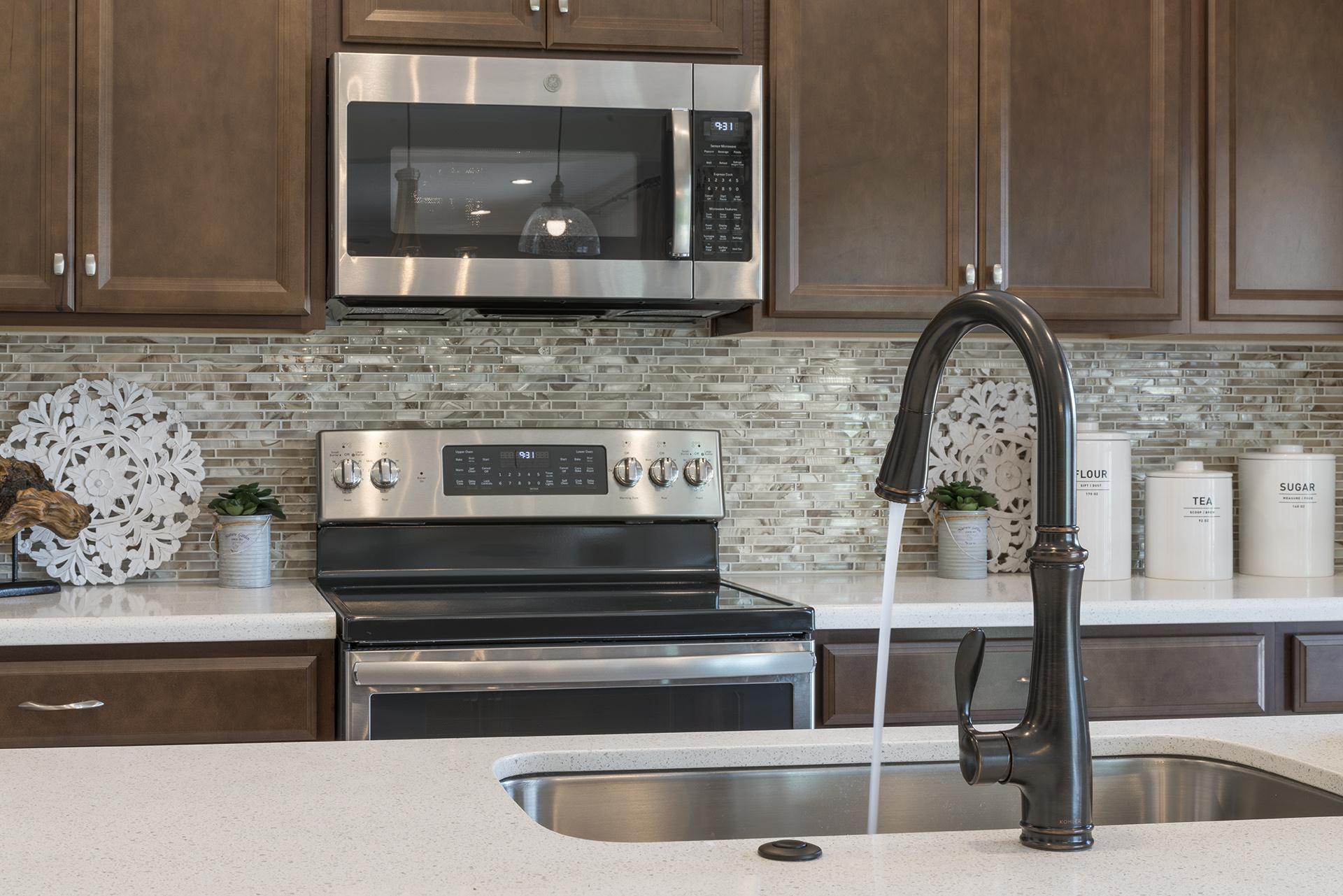 Kitchen featured in the Newcastle Premier By Hanover Family Builders in Orlando, FL