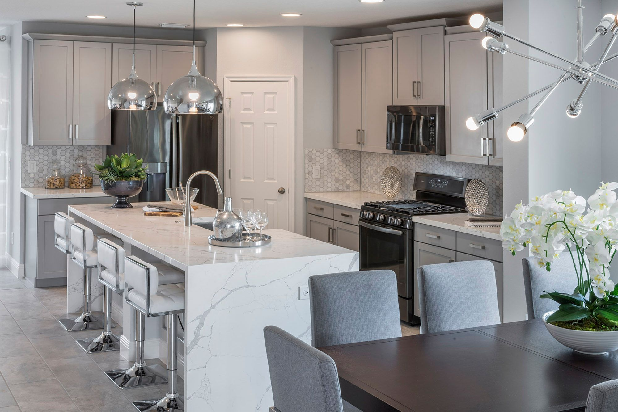 Kitchen featured in the Wilshire By Hanover Family Builders in Orlando, FL