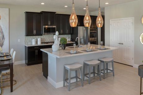 Kitchen-in-Palmer Premier-at-Hanover Lakes-in-Saint Cloud
