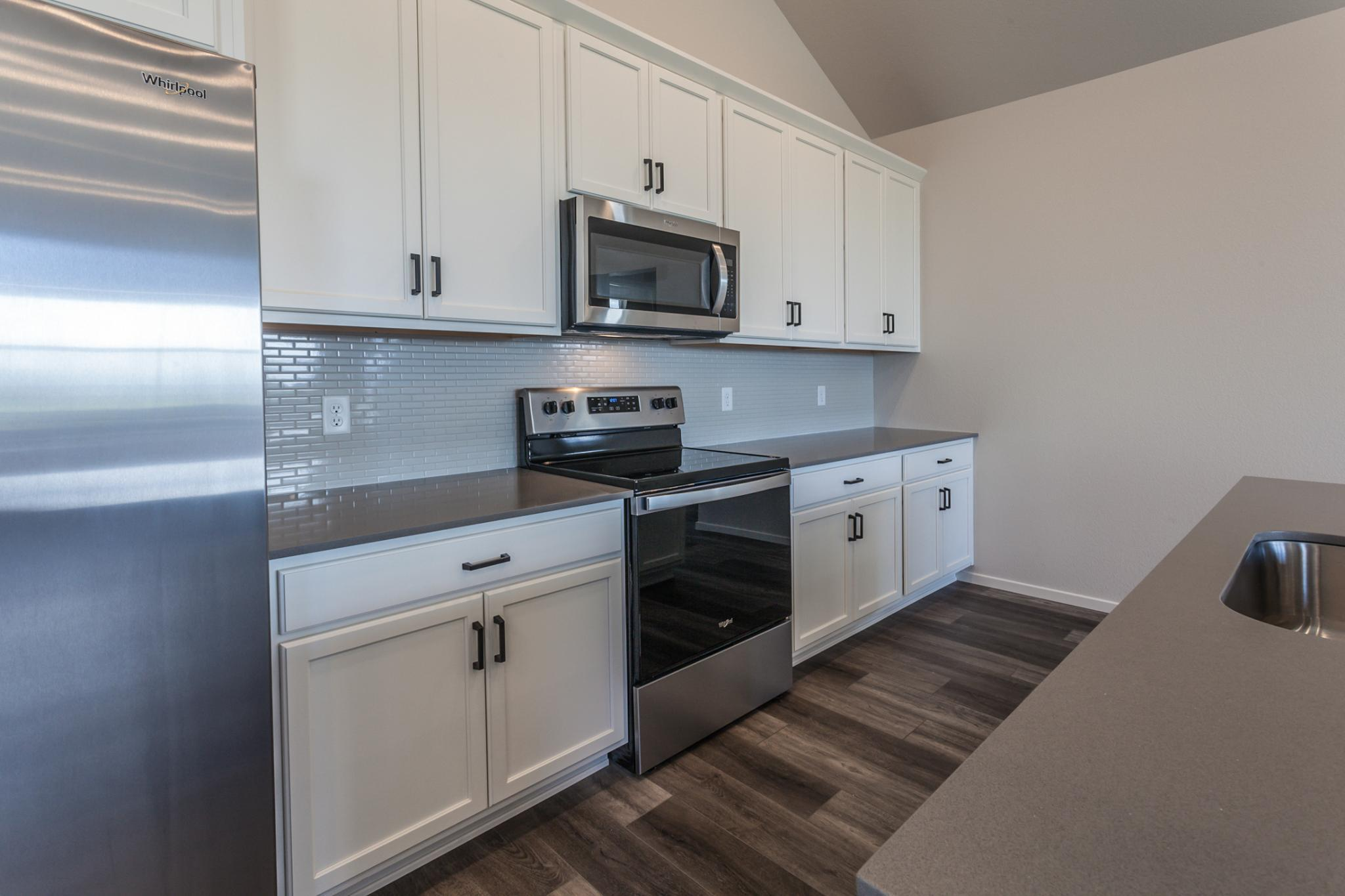 Kitchen featured in the Rockefeller By Hartford Homes in Greeley, CO