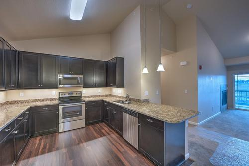 Kitchen-in-The Heather-at-Fairview Condominium at Fox Meadow-in-Longmont