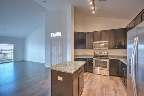 Kitchen-in-The Jasmine-at-Fairview Condominium at Fox Meadow-in-Longmont