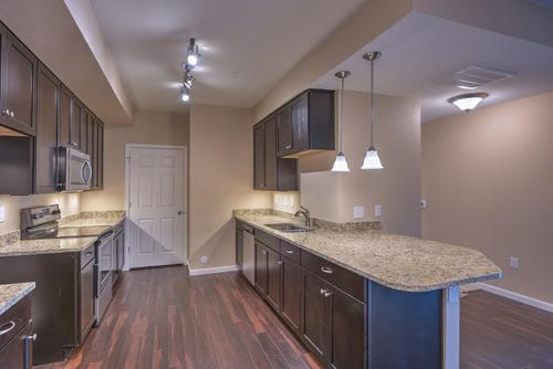 Kitchen-in-The Mulberry-at-Fairview Condominium at Fox Meadow-in-Longmont