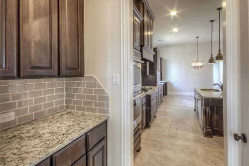 Kitchen-in-Plan 2931-at-Woodforest 85s-in-Montgomery