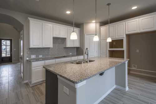 Kitchen-in-Plan 557H-at-Wellington: 50ft. lots-in-Haslet