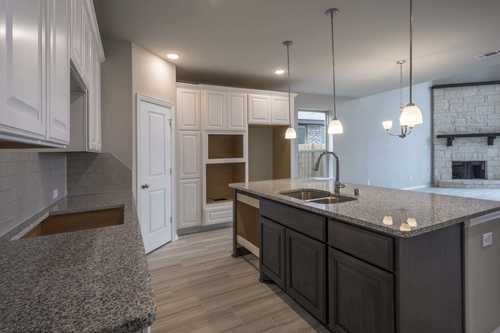 Kitchen-in-Plan 557H-at-Cane Island: 55ft. lots-in-Katy