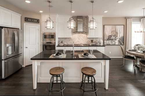 Kitchen-in-Plan 559H-at-Cane Island: 55ft. lots-in-Katy