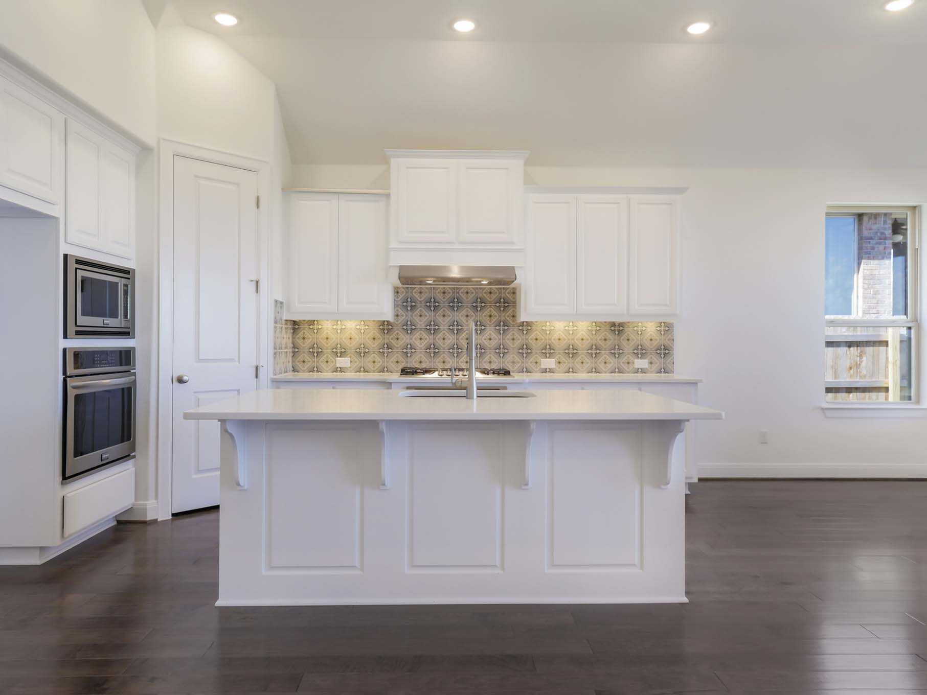 Kitchen-in-Plan 554-at-Santa Rita Ranch North: 60ft. lots-in-Liberty Hill