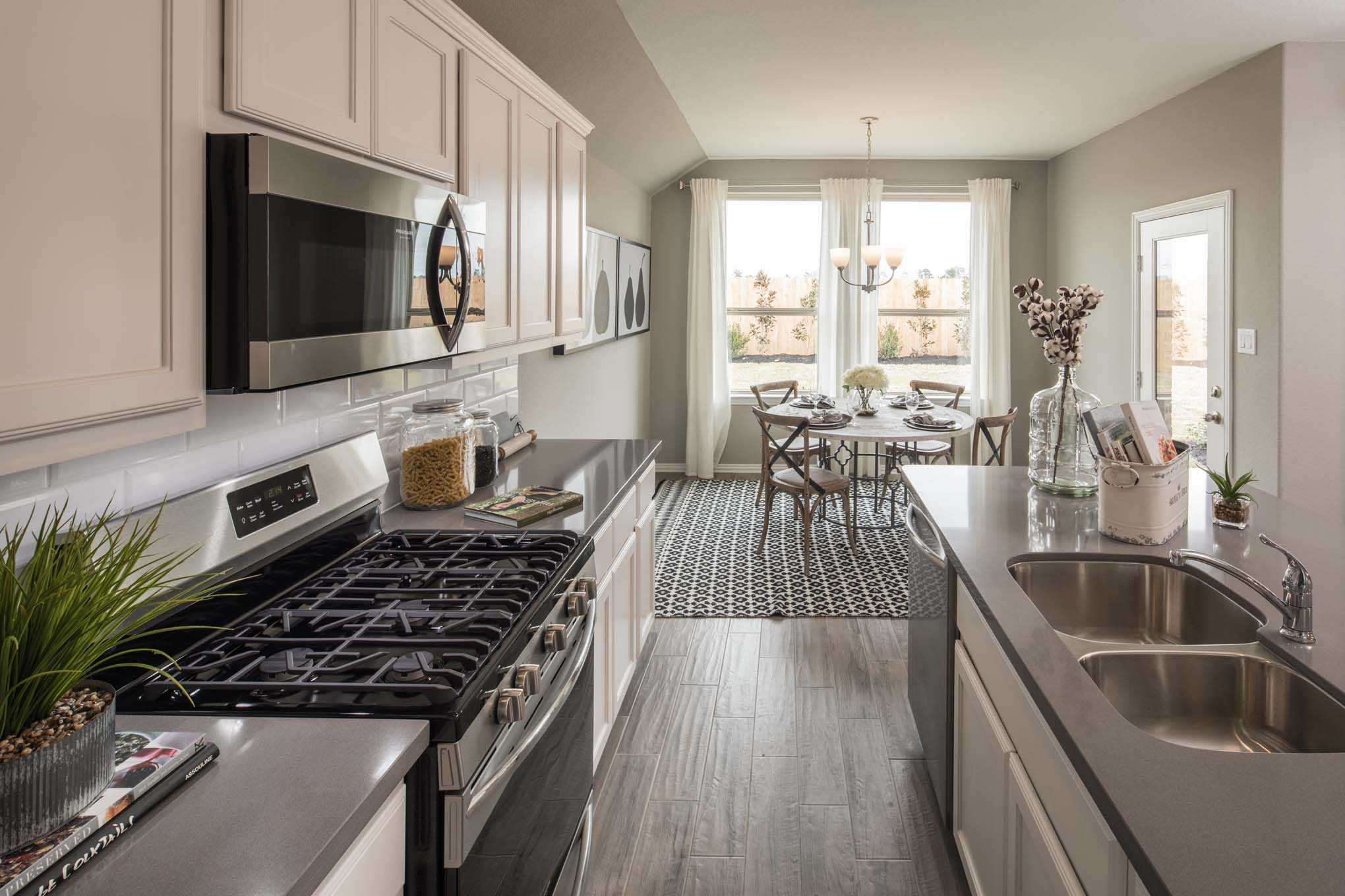 Kitchen-in-Plan Ashwood-at-Lakeside at Tessera on Lake Travis: 50ft. lots-in-Lago Vista