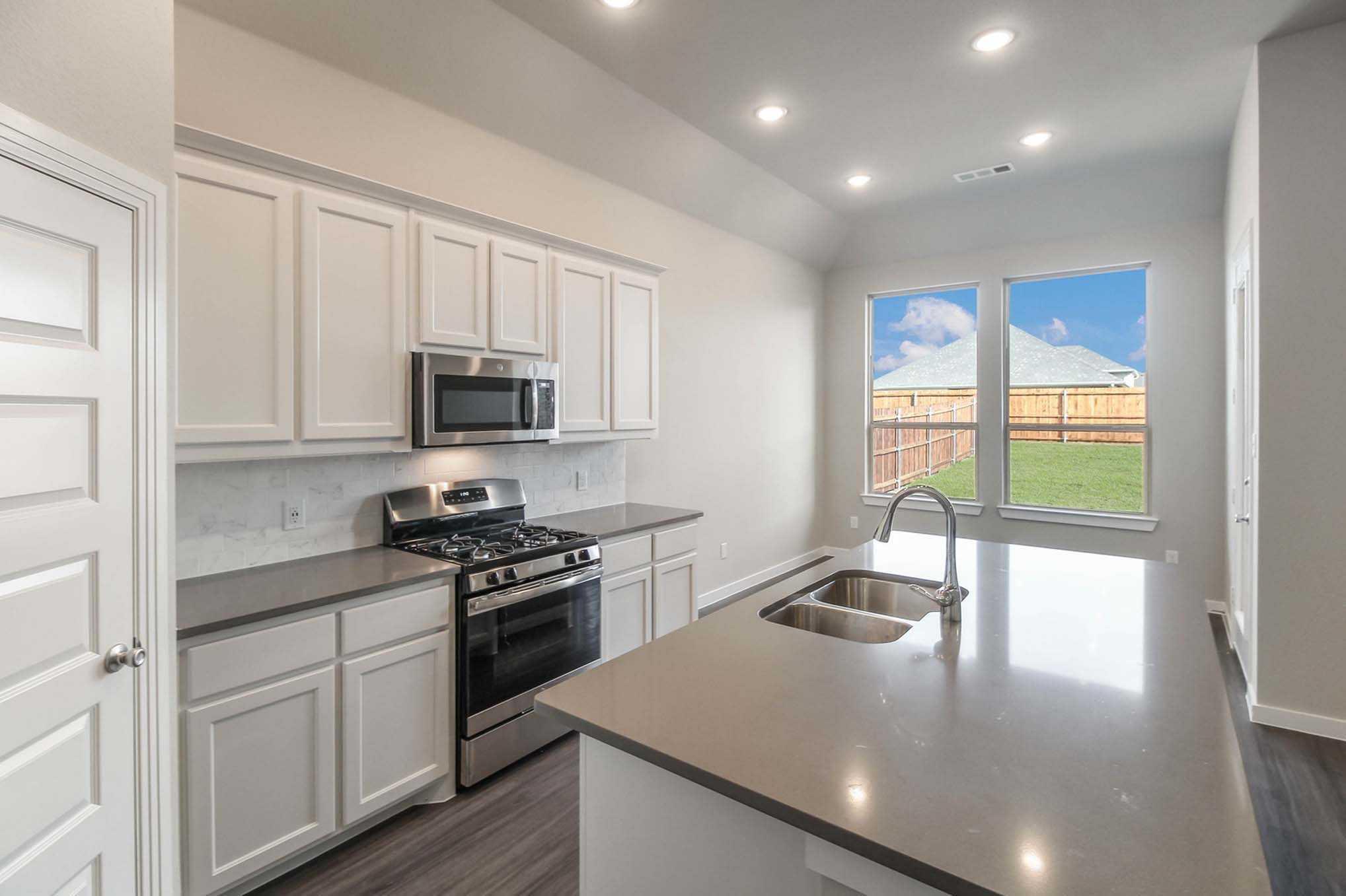 Kitchen featured in the Plan Camden By Highland Homes in San Antonio, TX