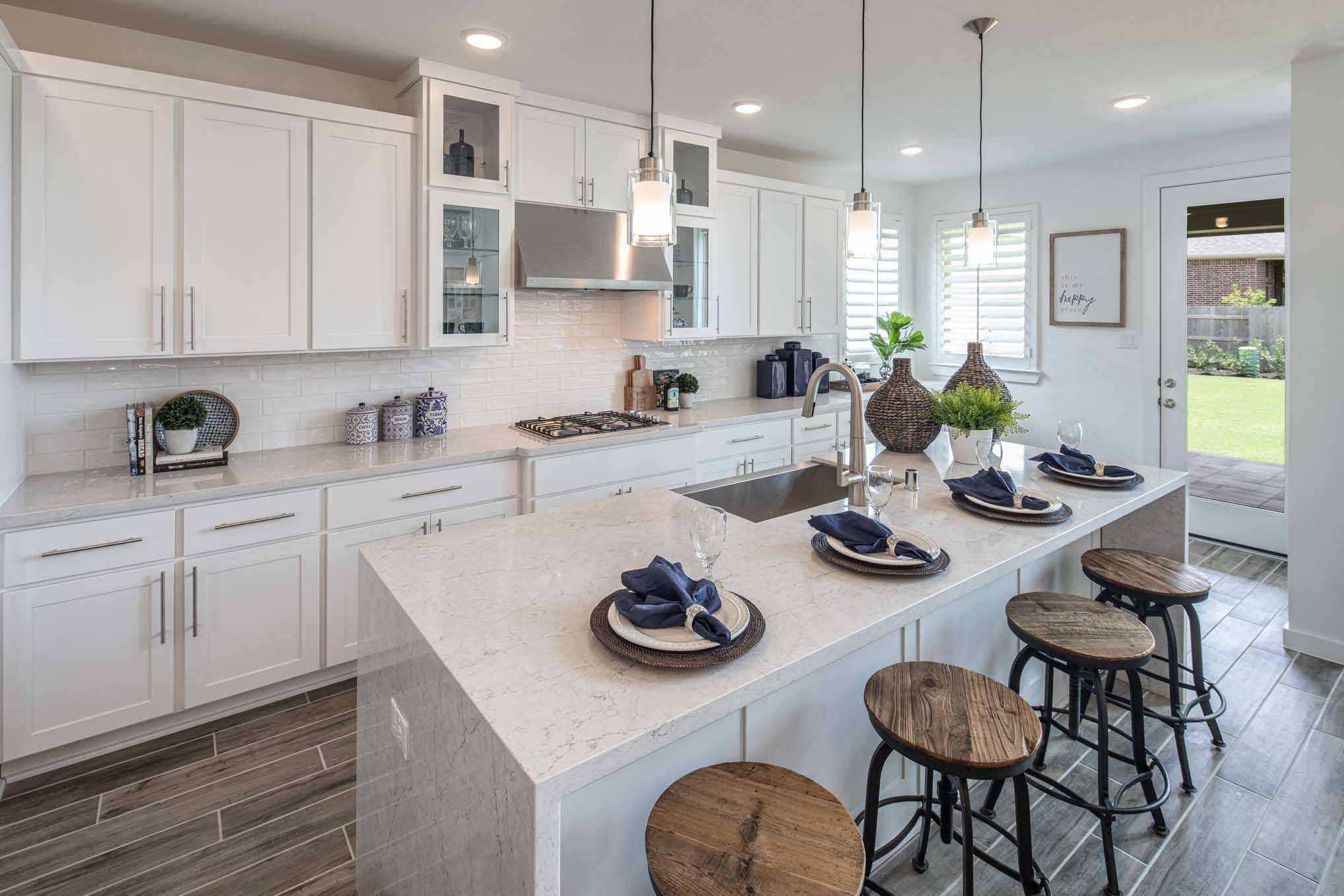 Kitchen featured in the Plan 556H By Highland Homes in Dallas, TX