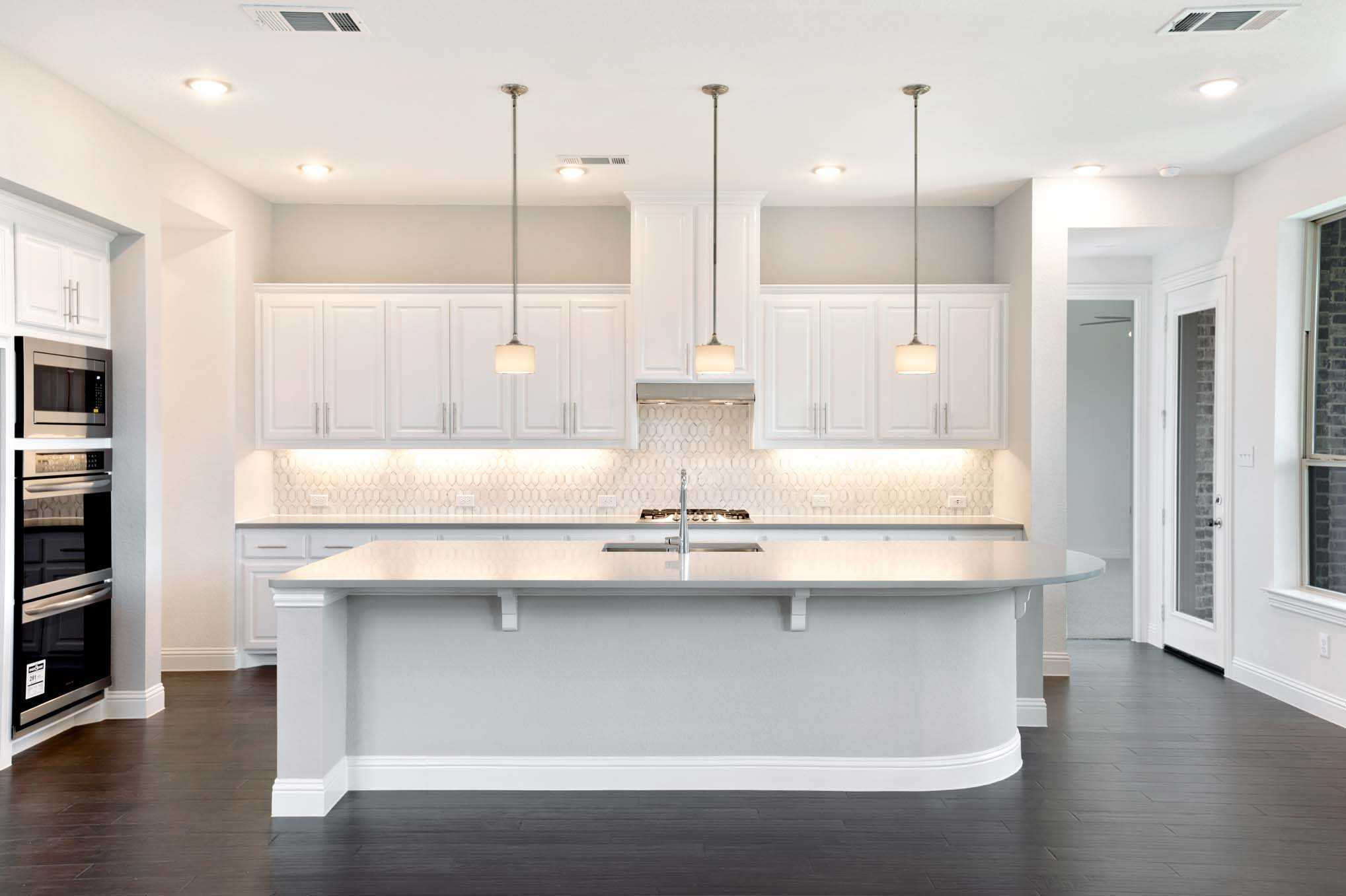 Kitchen featured in the Plan 221 By Highland Homes in Dallas, TX